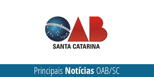"""logo da OAB de Santa Catarina, sendo a letra O tem o mesmo desenho do centro da Bandeira do Brasil: um círculo azul com estrelas e a faixa """"ordem e progresso"""""""